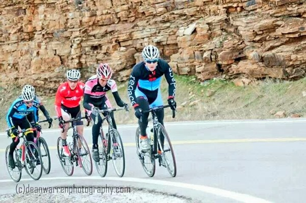 Leading the group over Carter Lake Dam on the last lap