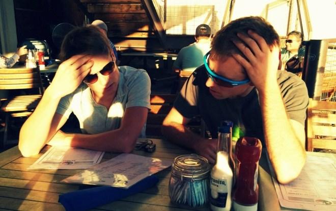 Important decision: Blake and Bryan deliberate the beer menu
