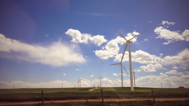 Windmills fill the horizon on the grassy plains of southern wyoming. Photo from Bryan Alders