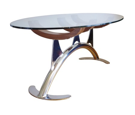 Glass coffee table. Combining a mix of wood, metal and glass, this oval glass coffee table ticks all the boxes when it comes to contemporary designer furniture.