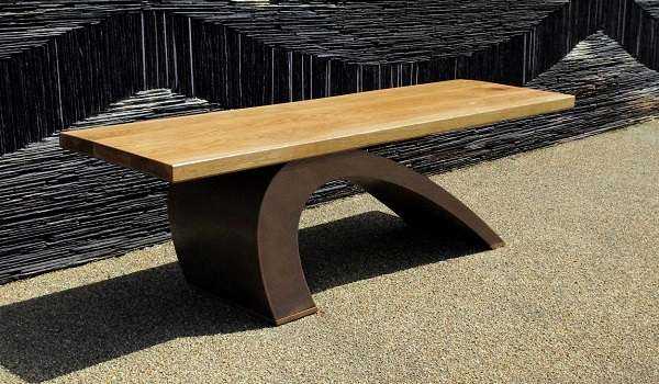 Modern garden bench in bronze.