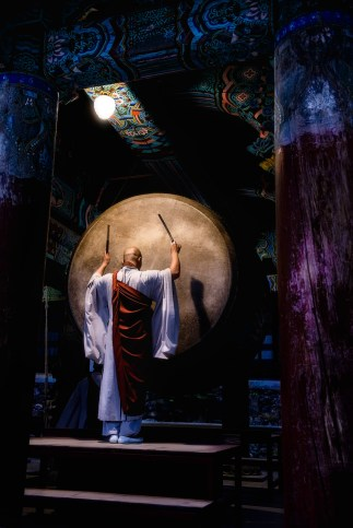 Monk plays drums at Haeinsa temple