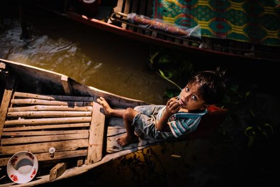 Boy on boat at Kampong Phluk