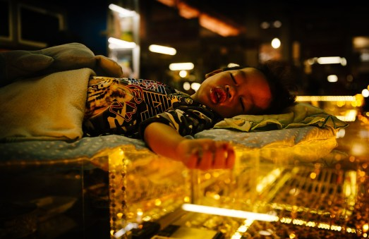 Sleeping boy at Psah Leu Market, Siem Reap