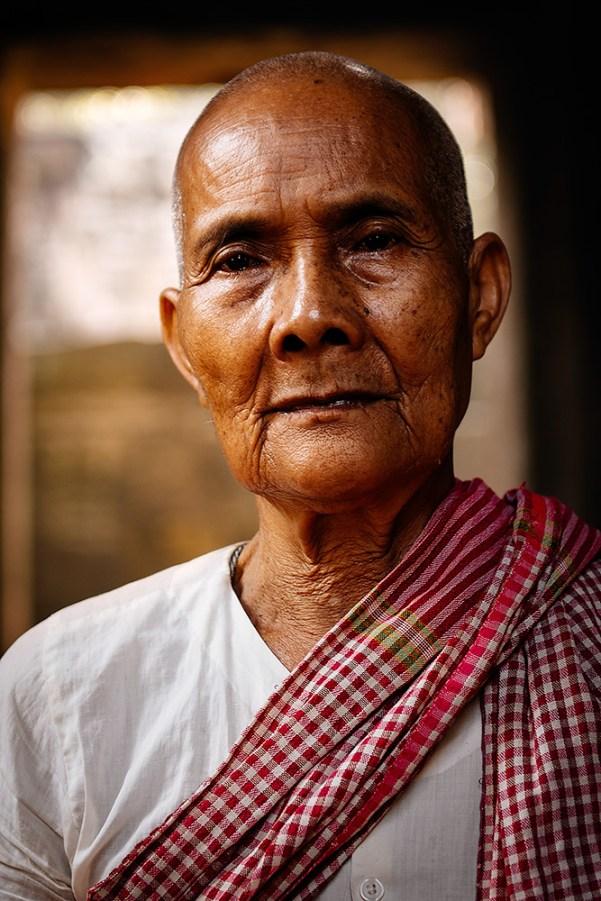 An elderly nun at Banteay Kdei temple in Angkor, Cambodia