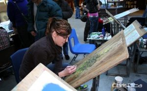 A Red River college student works on her art during a previous year's show. (HANDOUT)