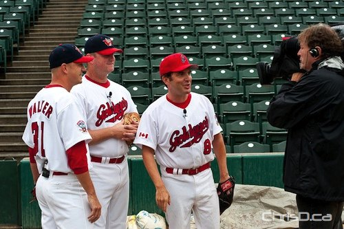 "Comedian Rick Mercer films a segment for ""The Rick Mercer Report"" alongside Winnipeg Goldeyes manager Rick Forney (centre) and pitcher Ace Walker at Canwest Park on Saturday, August 28, 2010. (TED GRANT / CHRISD.CA)"