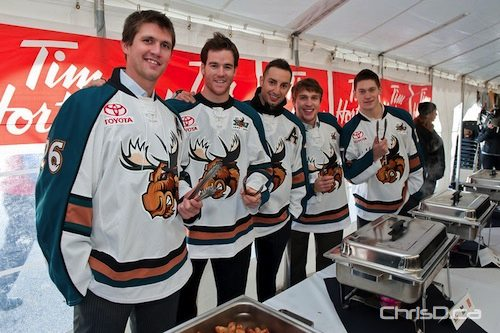 Members of the Manitoba Moose serve up breakfast at the Gateway Community Centre on Sunday, October 17, 2010. (TED GRANT / CHRISD.CA)
