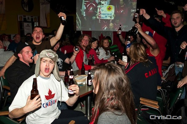 Fans celebrate at the Oakbank Motor Hotel -- prior to Team Canada's loss -- to cheer on local boy Quinton Howden during the 2011 World Junior Hockey Championship gold medal game against Russia on Wednesday, January 5, 2011. (TED GRANT / CHRISD.CA)