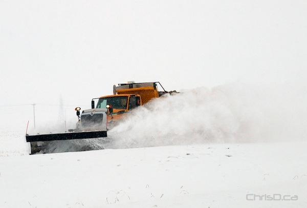 A snow plow clears the way on McPhillips Street on Friday, January 14, 2011. (STAN MILOSEVIC / MANITOBAPHOTOS.COM)