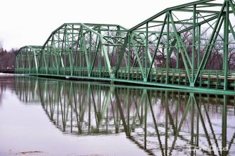 The bridge in St. Jean Baptiste will be closed soon as river water approaches the roadway. (MARC EVANS / CHRISD.CA)