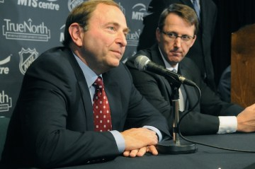NHL Commissioner Gary Bettman and True North Chairman Mark Chipman attend a news conference to announce the return of the NHL to Winnipeg at MTS Centre on Tuesday, May 31, 2011. (JAMES TURNER / METRO NEWS)