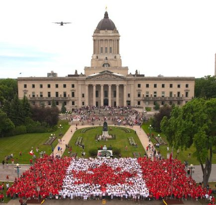 Thousands of people assemble at the Manitoba legislature Friday, July 1, 2011 to create a living flag made by wearing red and white T-shirts. (RON GILFILLAN MPA, F. PH. / DOWNTOWN BIZ)