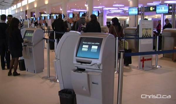 One of the many common-use check-in kiosks on the departures level of the James Richardson International Airport. (CHRISD.CA)
