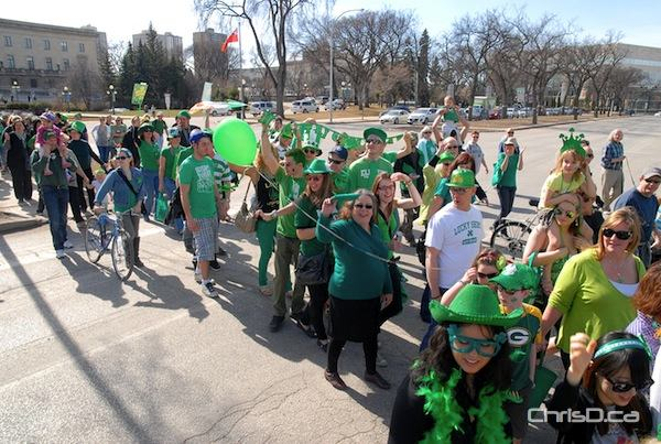 Hundreds of people cross Broadway during the first annual St. Patrick's Day Parade in downtown Winnipeg on Saturday, March 17, 2012. (STAN MILOSEVIC / MANITOBAPHOTOS.COM)