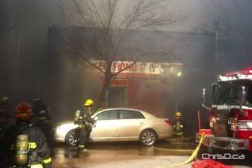 Firefighters attempt to save the neighbouring Ken Hong Restaurant at 38 Albert Street on Thursday. (STAN MILOSEVIC / CHRISD.CA)