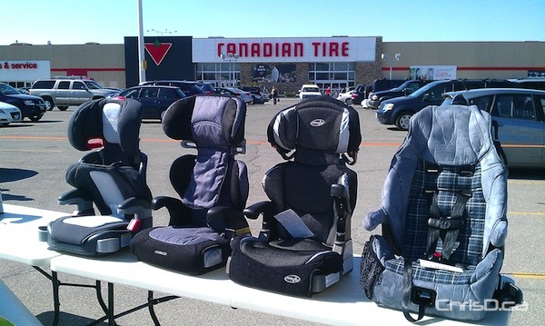 Booster seats are displayed during a provincial photo-op at a Winnipeg Canadian Tire over the weekend. (CHRISD.CA)