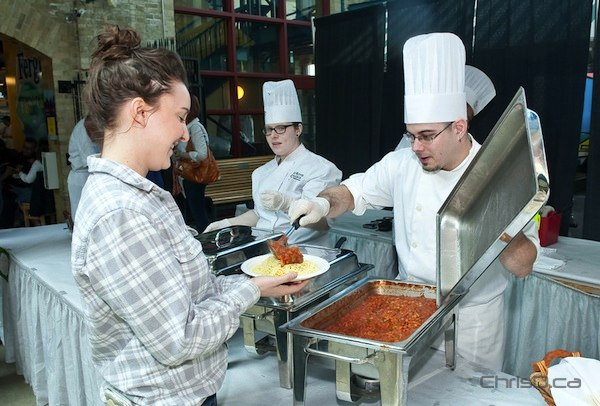 Future chef and Red River College student Leo Matt serves up a plate of pasta and sauce at The Forks on Saturday, April 7, 2012. (TED GRANT / CHRISD.CA)