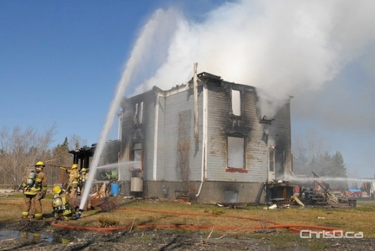 Firefighters extinguish a large blaze at a home in West St. Paul on Monday, April 16, 2012. (STAN MILOSEVIC / CHRISD.CA)