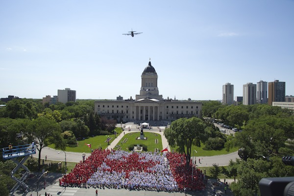 Thousands of Winnipeggers form a giant living flag on Canada Day, Sunday, July 1, 2012 at the Manitoba legislature. (RON GILFILLAN / DOWNTOWN WINNIPEG BIZ)