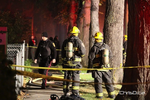 Firefighters tend to a blaze at 233 Lansdowne Avenue early Sunday, September 23, 2012. (HOWARD WONG PHOTO)