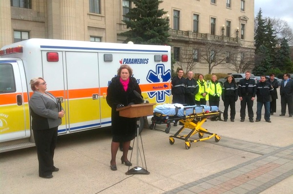 Health Minister Theresa Oswald announces new power lift stretchers to assist Manitoba paramedics lift increasingly heavier patients while on the job. (WINNIPEG PARAMEDICS / TWITTER)