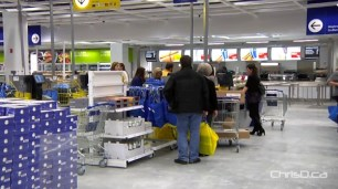 Shoppers pay for items during a preview night at IKEA Winnipeg earlier this week. (CHRISD.CA)
