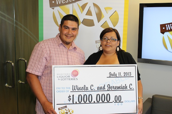 Jeremiah Courchene and Winola Canard display their giant cheque after winning $1 million in a Western Max draw. (WCLC / HANDOUT)