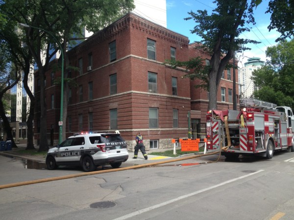 Emergency personnel at the scene of a building on Assiniboine Avenue on Tuesday, August 6, 2013. (METRO WINNIPEG/SHANE GIBSON)