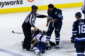 Winnipeg Jets forward Dustin Byfuglien (33) fights Tampa Bay Lightning defenceman Radko Gudas (7) in play at MTS Centre on Friday. (SHAWN COATES / CHRISD.CA)