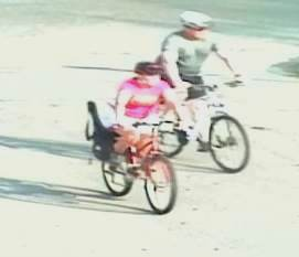 Winnipeg police are hoping to identify these two people on bikes as possible witnesses. (WPS/HANDOUT)