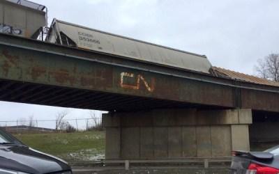 CN Derailment Leaves Rail Cars Leaning Against Winnipeg Bridge
