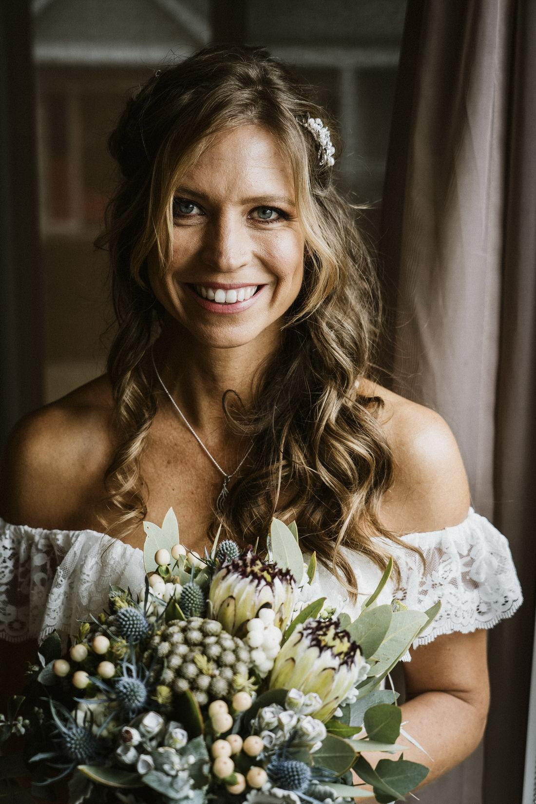 Smiling bride portrait by Bright Wedding Photographer