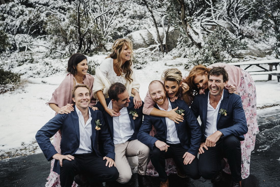 Snow wedding photography of bridal party by Albury wedding photographer