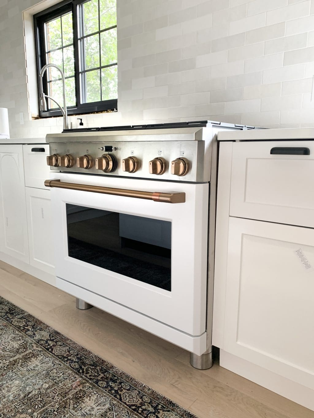 white and brush bronze cafe appliances