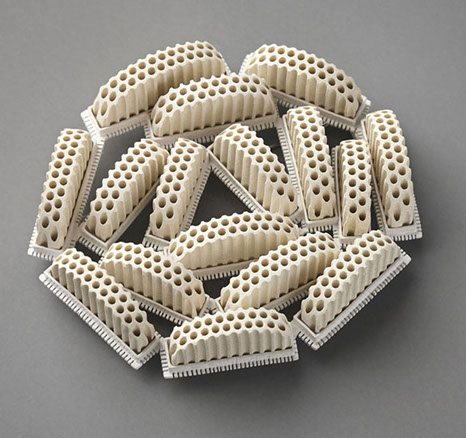 "Christel van der Laan - ""Holier Than Thou"" (2009). Brooch: painted silver, ceramic honeycomb block"