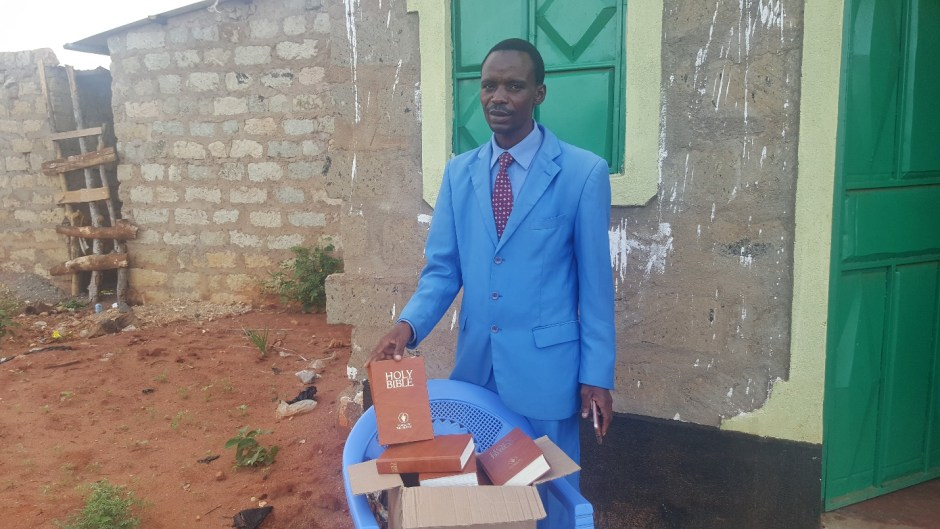 Kenyan Pastor with bibles