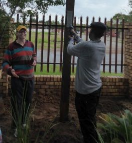 Sechaba Molefe attaching the plaque