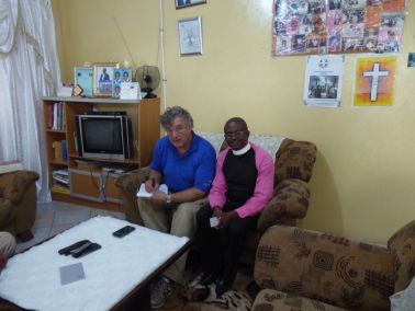 Pastor Bill works with Pastor Matya on his Testimony