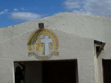 Church logo painted on building
