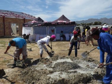 Mixing sand, rock and cement to make concrete
