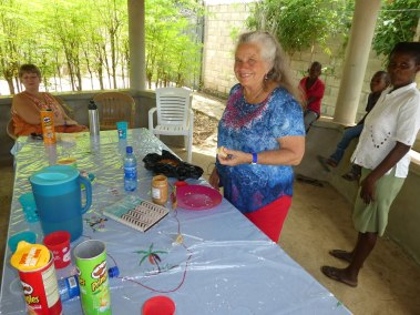 Pastor Carol preparing peanut butter sandwiches for everyone