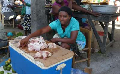 Buying chicken in the open market