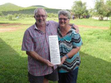 Callie and Marinda holding Plaque Delcaring God's Glory over Gaborone and the Village