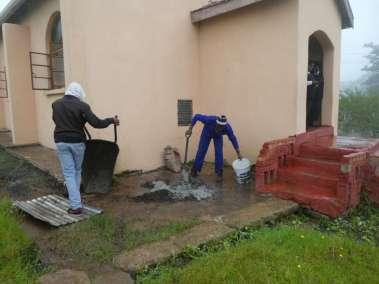 Mixing concrete in the rain