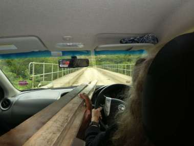 Pastor Carol navigates down Mt to 1 lane bridge over the Kei River and back up Mt
