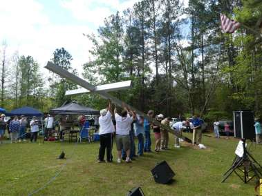 Gang of Music goers lifting Cross