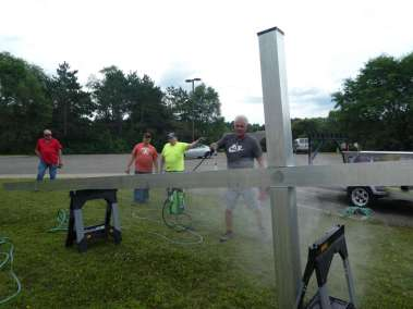 Pastor Randy power washing Cross