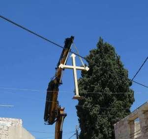 Lifting Cross toward roof