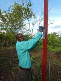 Pastor Mudenda Attaching Plaque